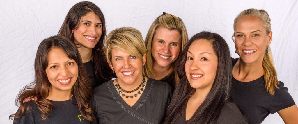 Group portrait of Dr. Haley Ritchey and staff in the studio